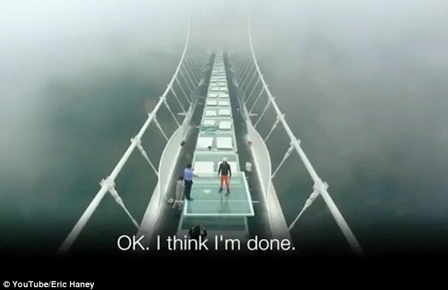 The stunt was intended to promote the safety of the skywalk, after another glass bridge in China shattered when a tourist dropped a mug in September, causing panicked crowds to flee in terror